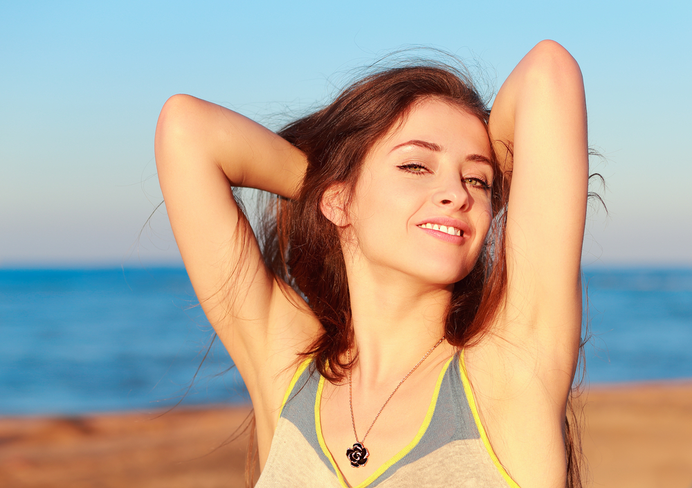 Woman showas the armpits deodorant