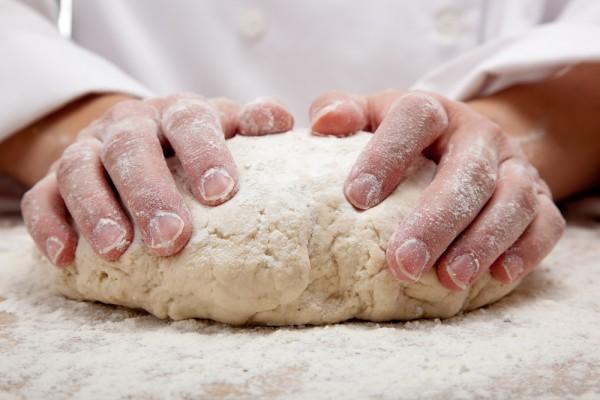 Baker's hands making bread