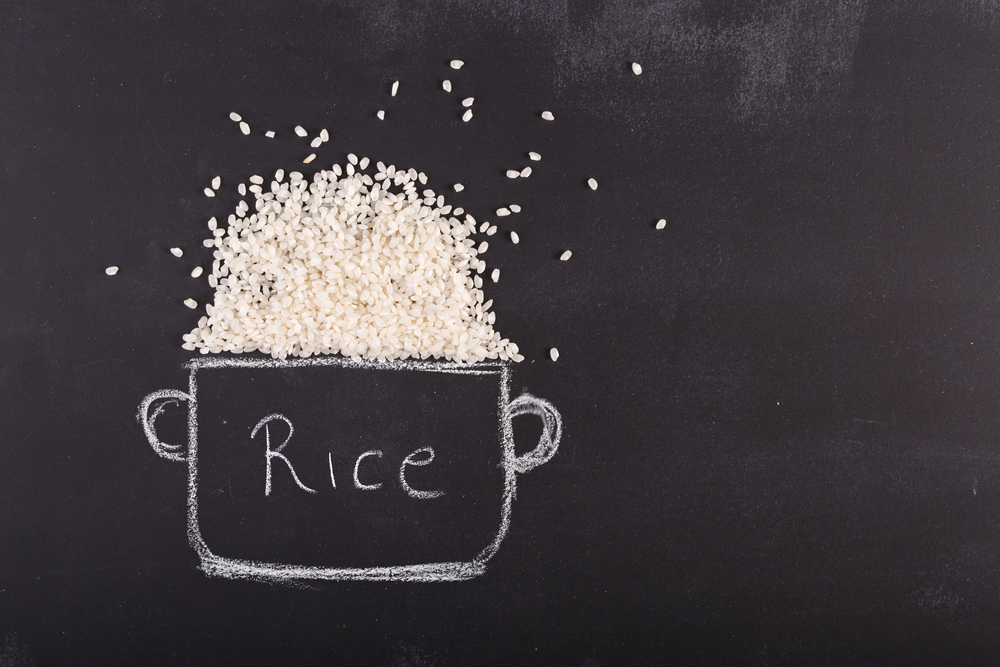 Real rice and drawn bowl on chalk board