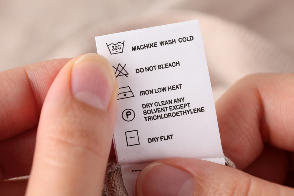 Label on clothes Wash dry clean bleach iron triclohoethylene