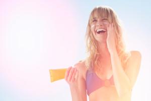 Sun screen block girl on the beach sea