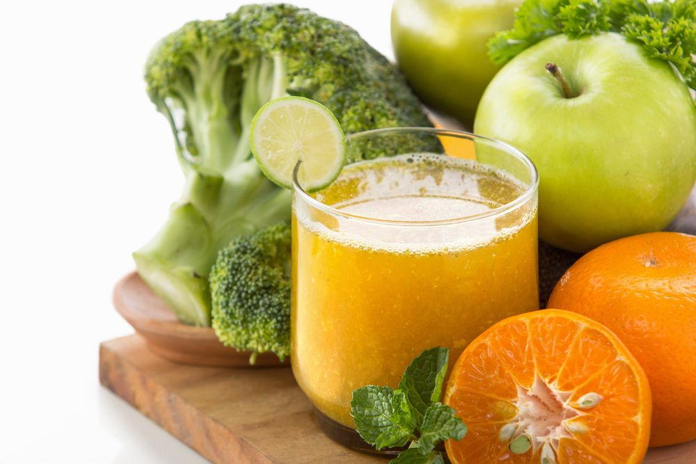 Healthy smoothie with apples, orange and broccoli