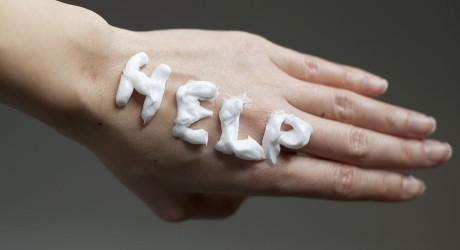 Help Note with Moisturizer Cream on Dry Skin Hand