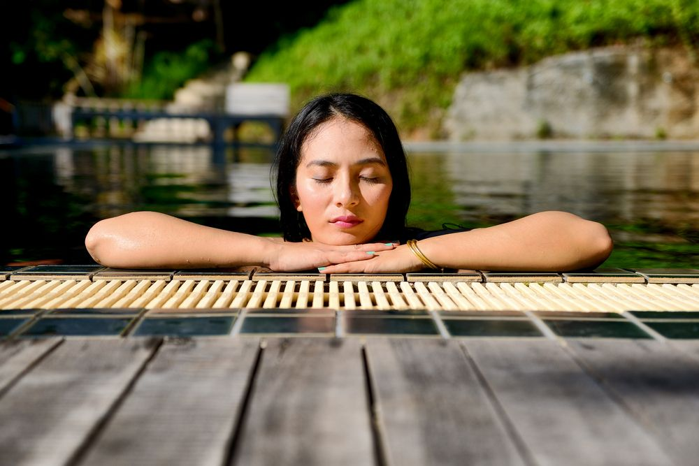 Woman enjoy relaxing in the pool spa
