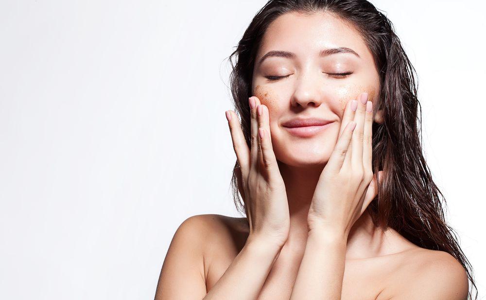 Woman scrub cleanses the skin
