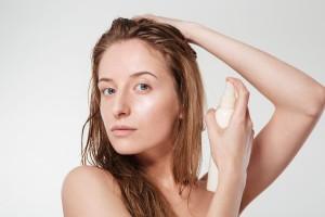 woman spraying hairspray