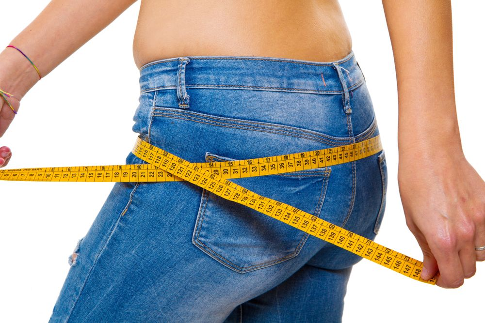 woman tape measure diet lose weight