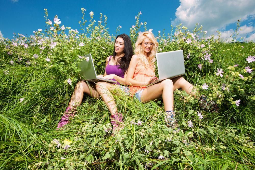 girl computer green grass