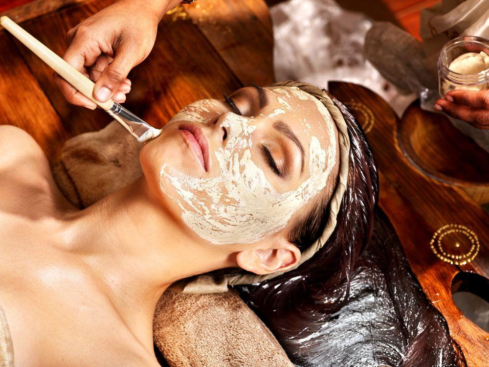 woman-having-facial-mask-at-ayurveda-spa