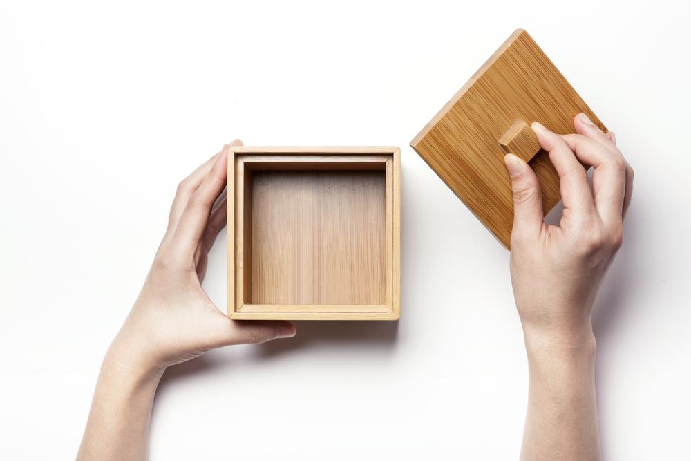 wooden box in hands