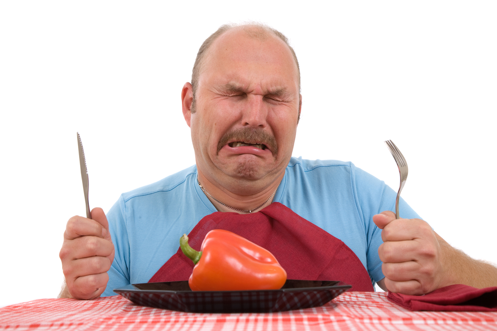Man crying over the bell pepper