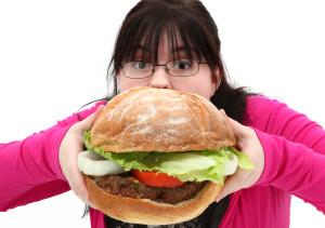 Girl eats huge hamburger