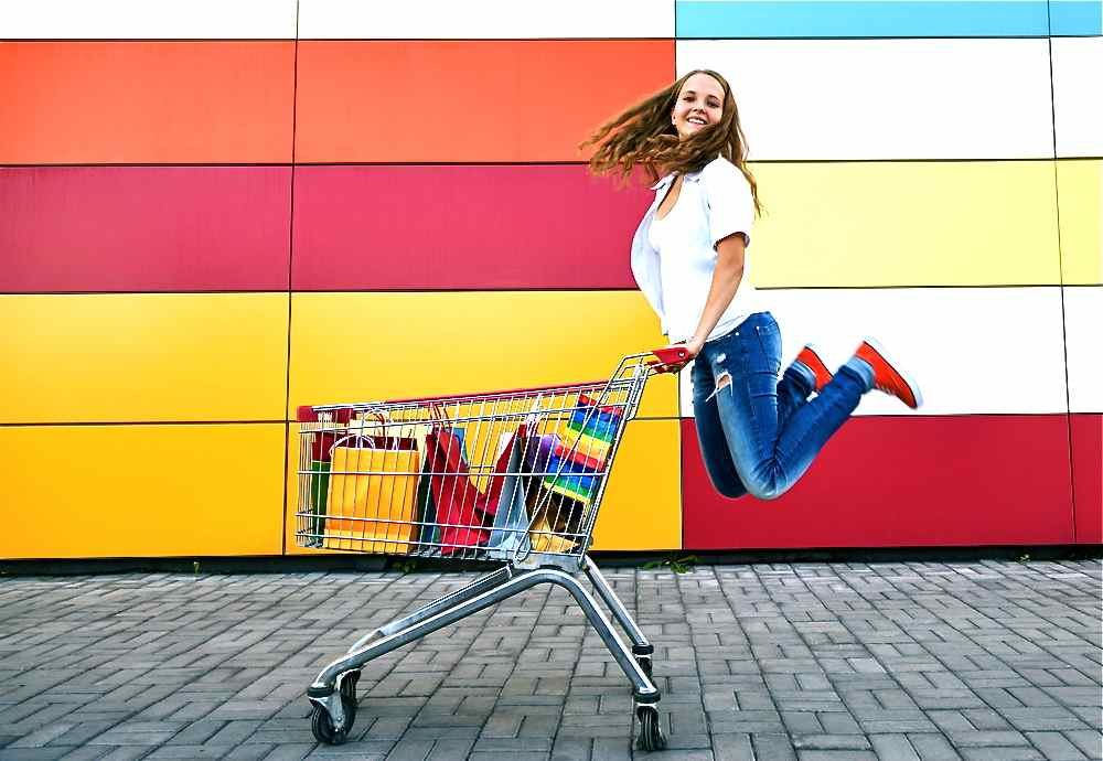 Girl with the shopping cart jumping