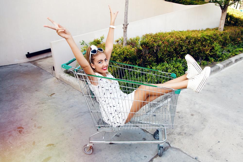 Girl in a shopping cart