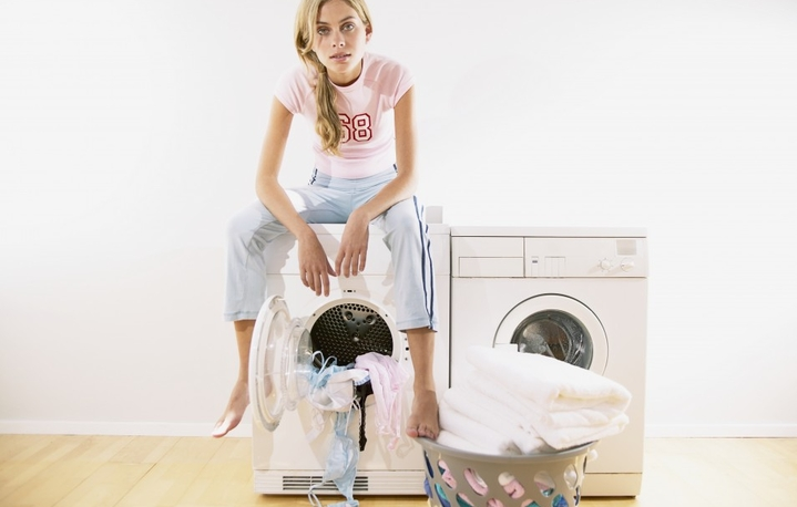 woman on a washing machine