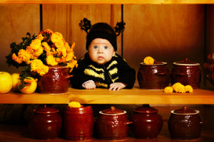 Honey kid in funny bee costume