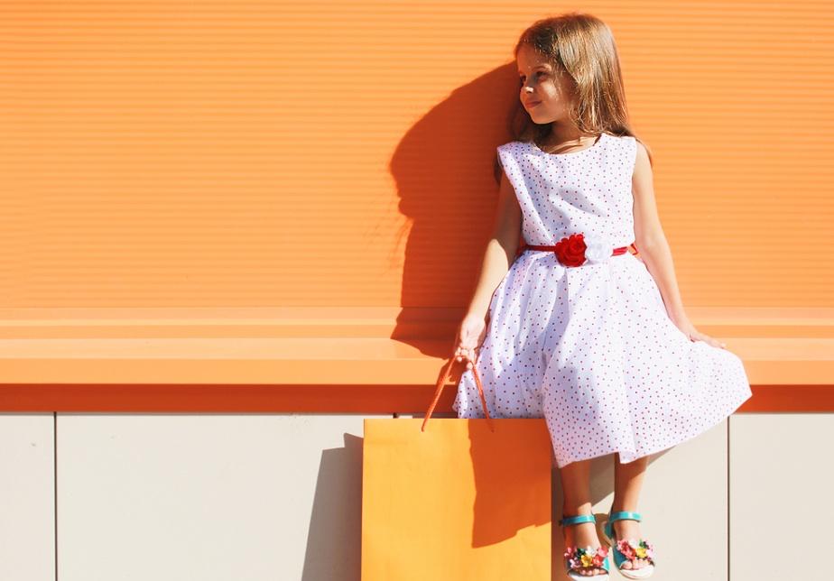 small girl sunny shopping