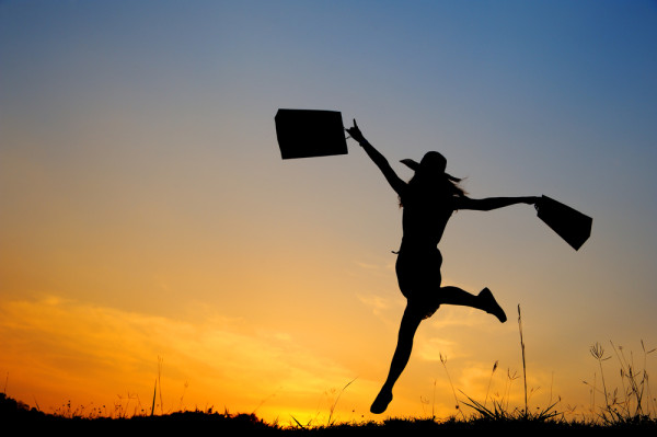 Woman with shopping bags jumps summer evening girl ballet field joy