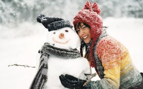 6969108-snowman-brunette-girl-smile-winter-snowflakes