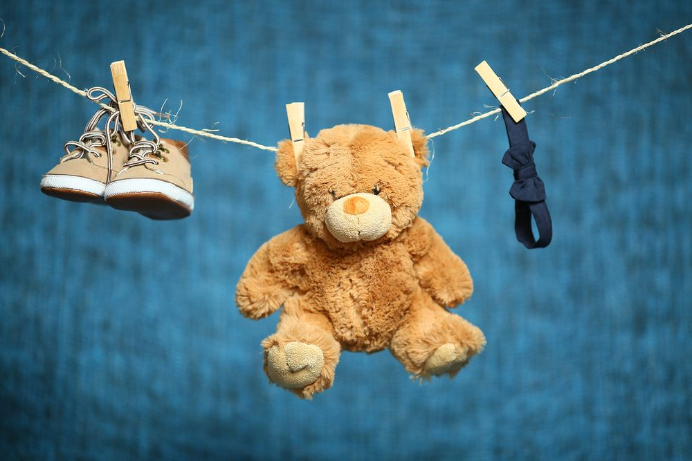 brown toy bear laundry