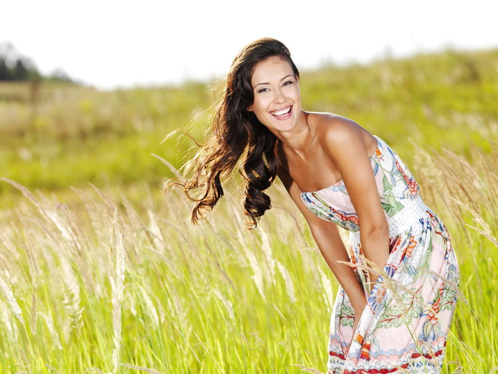oung beautiful smiling woman outdoors
