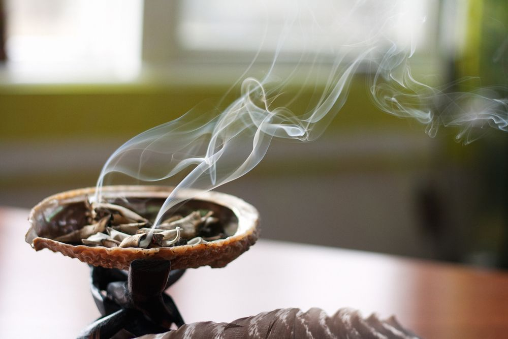 smudging herbs in a shell