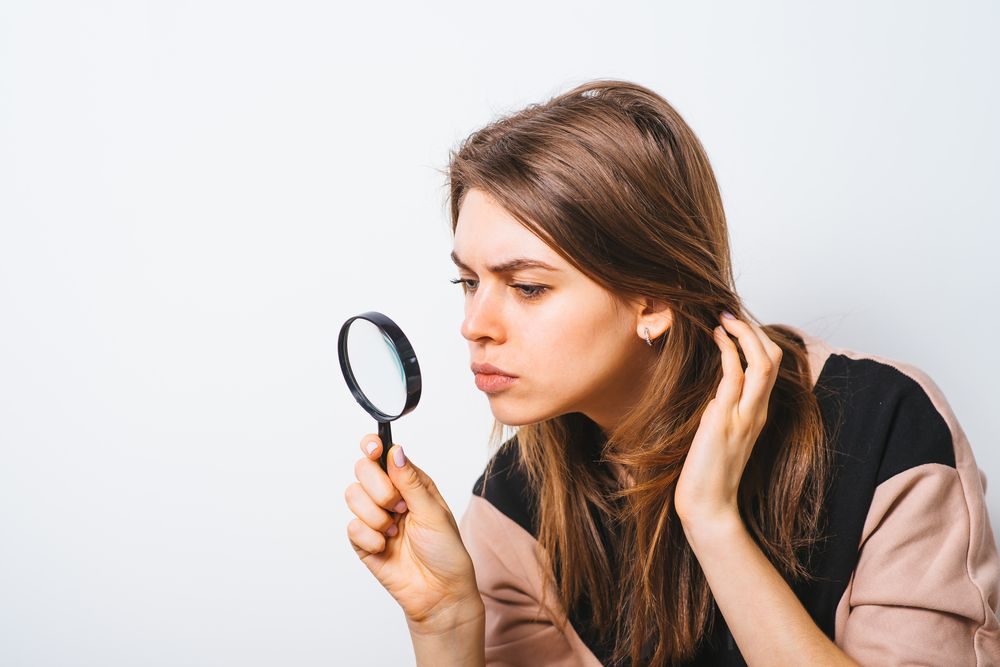 Woman magnifying glass search