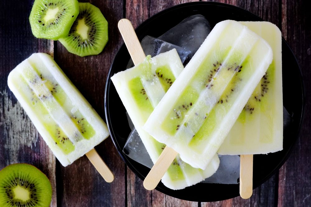 Bowl of kiwi vanilla yogurt popsicles ice cream