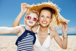 mother and daughter beach sun woman summer