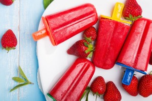 strawberry popsicles with colorful sticks ice cream