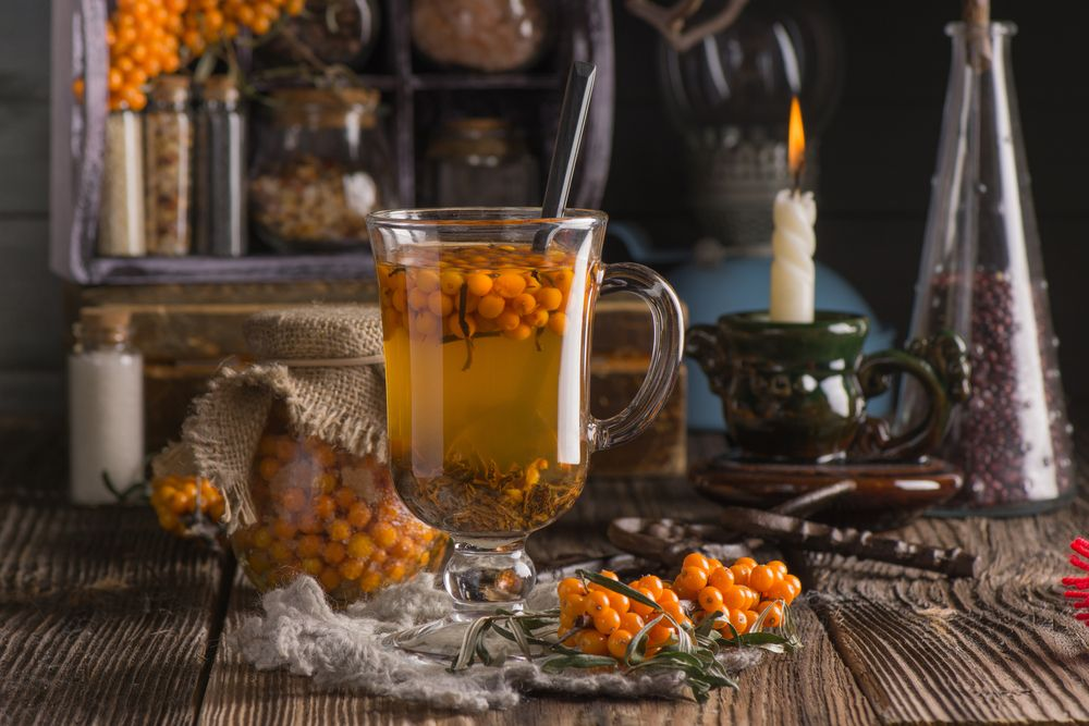 autumn-still-life-with-hot-high-vitamin-beverage-with-seabuckthorn-in-the-tall-glass