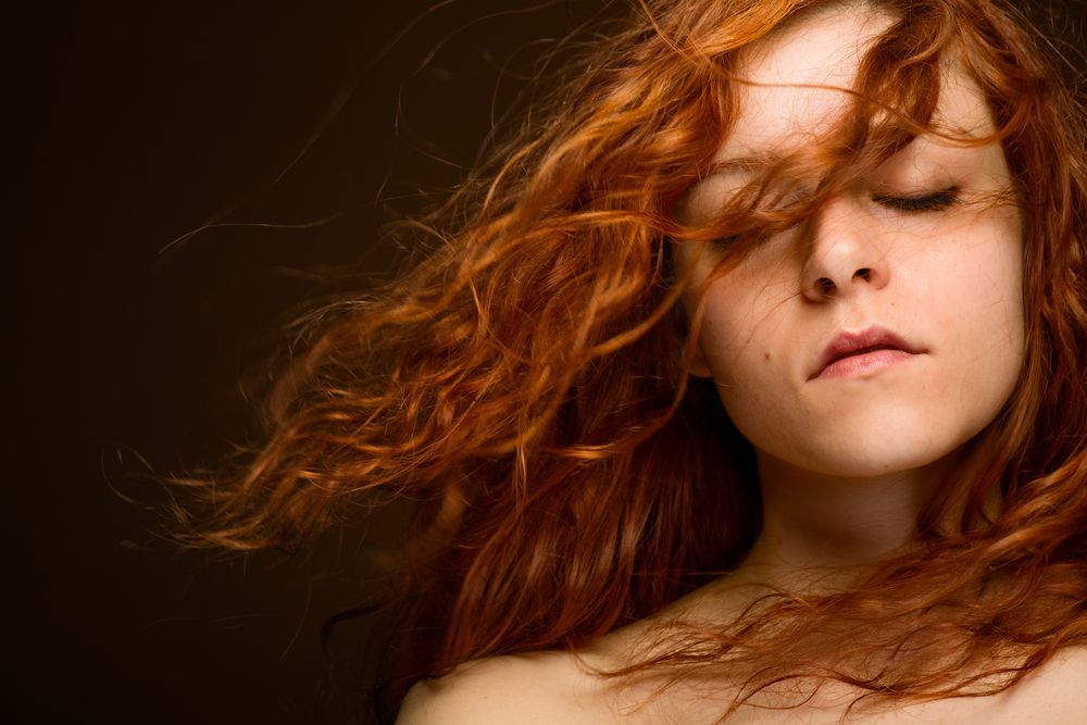 sexy-redhead-woman-with-blurred-hair