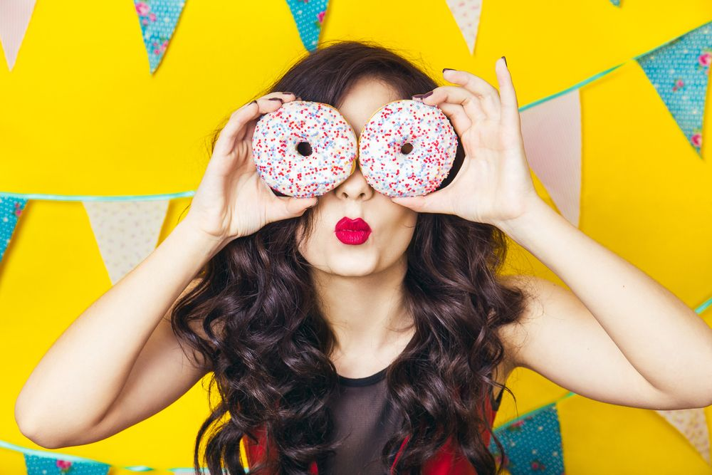 beauty-girl-taking-colorful-donuts-funny-joyful-woman-with-sweets-dessert