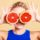 woman-girl-holding-two-halfs-of-grapefruit-citrus-fruit