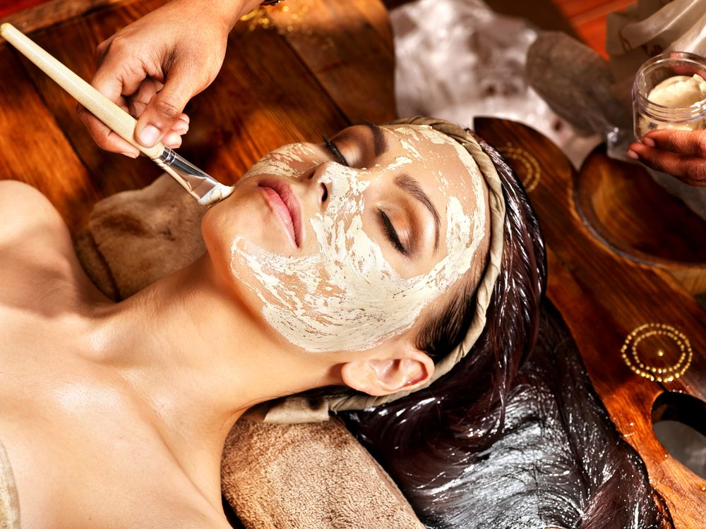 woman-having-facial-mask-at-ayurveda-spa