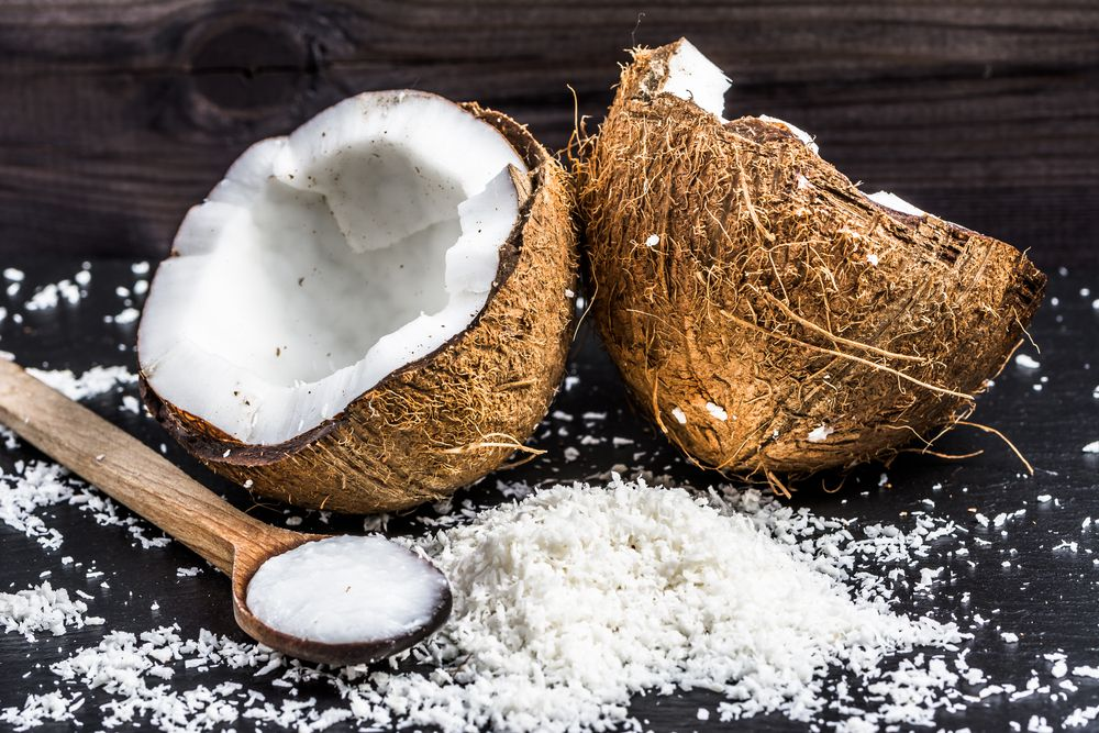 fresh-coconut-and-coconut-oil-on-wooden-spoon