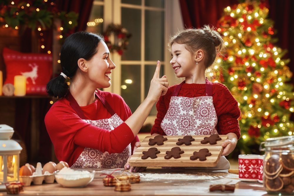 merry-christmas-and-happy-holidays-family-preparation-holiday-food-mother-and-daughter-cooking-christmas-cookies