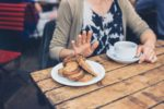 young-woman-on-gluten-free-diet-is-saying-no-thanks-to-toast-in-a-cafe